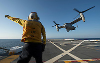 130423-N-DR144-380 Pacific Ocean (April 23, 2013)- Aviation Boatswain's Mate (Handling) 3rd Class Christopher Yakimovich directs an MV-22 Osprey assigned to Marine Medium Tiltrotor Squadron (VMM) 161 as it launches from the flight deck of the Amphibious Transport Dock Ship USS Anchorage (LPD 23). Anchorage is currently en route to its namesake city of Anchorage, Alaska for its commissioning ceremony May 4. (U.S. Navy photo by Mass Communication Specialist 1st Class James R. Evans / RELEASED)