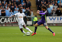 SWANSEA, WALES - MAY 17: (L-R) Nathan Dyer of Swansea is challenged by David Silva of Manchester City during the Premier League match between Swansea City and Manchester City at The Liberty Stadium on May 17, 2015 in Swansea, Wales. (photo by Athena Pictures/Getty Images)
