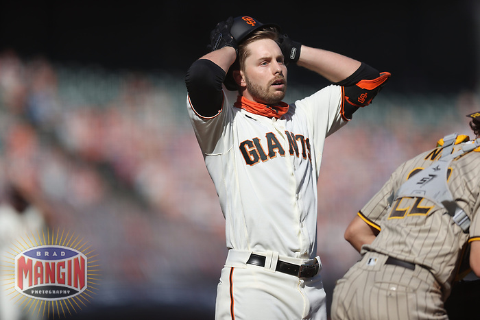 SAN FRANCISCO, CA - SEPTEMBER 27:  Austin Slater #13 of the San Francisco Giants reacts after taking a called third strike in the bottom of the 9th inning of their game against the San Diego Padres to end the game and the season at Oracle Park on Sunday, September 27, 2020 in San Francisco, California. (Photo by Brad Mangin)