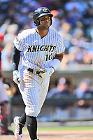 Charlotte Knights second baseman Yoan Moncada (10) runs to first base after being walked during a game against the  Gwinnett Braves at BB&T Ballpark on May 7, 2017 in Charlotte, North Carolina. The Knights defeated the Braves 7-1. (Tony Farlow/Four Seam Images)