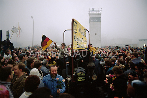 OLichterfelde, Berlin (West) and Teltow, Potsdam (East) crossing post, East Germany<br /> November 14, 1989  <br /> <br /> East Germans celebrate the opening of the Berlin Wall. Germans gathered as the wall is dismantled and the East German government lifts travel and emigration restrictions to the West on November 9, 1989.