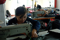Luo Xiao Yi (26) works at a sweatshop in a suburb of Guangzhou and makes bags for export to Europe and Australia.