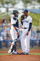 Charlotte Stone Crabs catcher Ronaldo Hernandez (27) talks with starting pitcher Resly Linares (17) during a Florida State League game against the Fort Myers Miracle on April 6, 2019 at Charlotte Sports Park in Port Charlotte, Florida.  Fort Myers defeated Charlotte 7-4.  (Mike Janes/Four Seam Images)