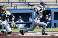 Western Michigan Broncos second baseman Andrew Stone (33) follows through on his swing against the Michigan Wolverines on March 18, 2019 in the NCAA baseball game at Ray Fisher Stadium in Ann Arbor, Michigan. Michigan defeated Western Michigan 12-5. (Andrew Woolley/Four Seam Images)