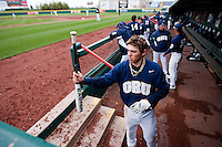 Cam Schiller (9) of the Oral Roberts Golden Eagles catches a teammate's bat while in the dugout during a game against the Missouri State Bears on March 27, 2011 at Hammons Field in Springfield, Missouri.  Photo By David Welker/Four Seam Images