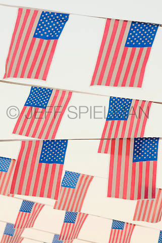 THIS IMAGE IS AVAILABLE EXCLUSIVELY FROM GETTY IMAGES<br /> <br /> Please search for image # sb10068416b-001 on www.gettyimages.com<br /> <br /> Flags of the United States of America (USA) and White Sky, Coney Island, New York City, New York State, USA
