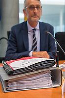"""10. Sitzung des """"1. Untersuchungsausschuss"""" der 19. Legislaturperiode des Deutschen Bundestag am Donnerstag den 17. Mai 2018 zur Aufklaerung des Terroranschlag durch den islamistischen Terroristen Anis Amri auf den Weihnachtsmarkt am Berliner Breitscheidplatz im Dezember 2016.<br /> In der Sitzung wurden in einer oeffentlichen Anhoerung als Sachverstaendige zum Thema: """"Foederale Sicherheitsarchitektur"""" u.a. der ehemalige Chef des Bundesamt fuer Verfassungssschutz (Heinz Fromm), der ehemalige Direktor des Bundeskriminalamt (Juergen Maurer) und Rechtswissenschaftler befragt.<br /> Im Bild: Ausschussakten vor dem  Ausschussvorsitzenden Armin Schuster (CDU).<br /> 17.5.2018, Berlin<br /> Copyright: Christian-Ditsch.de<br /> [Inhaltsveraendernde Manipulation des Fotos nur nach ausdruecklicher Genehmigung des Fotografen. Vereinbarungen ueber Abtretung von Persoenlichkeitsrechten/Model Release der abgebildeten Person/Personen liegen nicht vor. NO MODEL RELEASE! Nur fuer Redaktionelle Zwecke. Don't publish without copyright Christian-Ditsch.de, Veroeffentlichung nur mit Fotografennennung, sowie gegen Honorar, MwSt. und Beleg. Konto: I N G - D i B a, IBAN DE58500105175400192269, BIC INGDDEFFXXX, Kontakt: post@christian-ditsch.de<br /> Bei der Bearbeitung der Dateiinformationen darf die Urheberkennzeichnung in den EXIF- und  IPTC-Daten nicht entfernt werden, diese sind in digitalen Medien nach §95c UrhG rechtlich geschuetzt. Der Urhebervermerk wird gemaess §13 UrhG verlangt.]"""