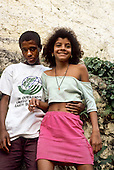 Rio de Janeiro, Brazil. Favela shanty town; teenage boy wearing Earth Summit t-shirt and girl holding a cigarette.