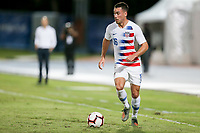GEORGETOWN, GRAND CAYMAN, CAYMAN ISLANDS - NOVEMBER 19: Daniel Lovitz #5 of the United States moves with the ball during a game between Cuba and USMNT at Truman Bodden Sports Complex on November 19, 2019 in Georgetown, Grand Cayman.