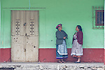 Latin America, Guatemala, Western Highlands, San Andres Xecul, Two Women at Green Wall
