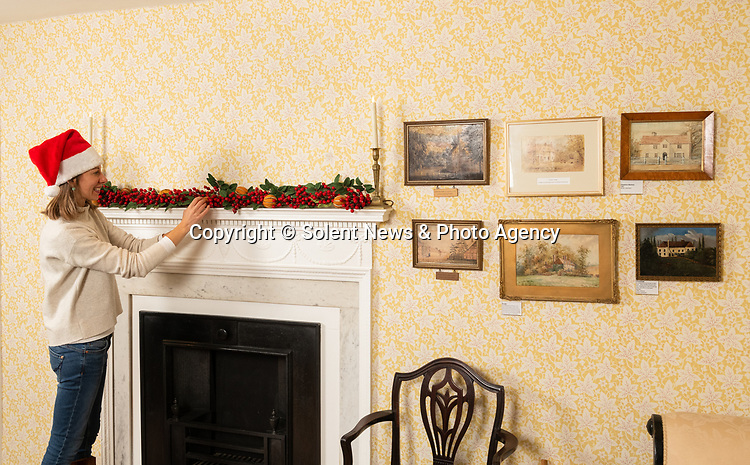 PPictured: Collections manager Sophie Reynolds lays down a Christmas garland on the mantlepiece in the drawing room as part of the Christmas experience as the Jane Austen's House Museum prepares to reopen to the public for the second time this year. <br /> <br /> Dame Emma Thompson has come to the aid of Jane Austen's former home by providing the voice to a new online Christmas experience.<br /> <br /> From today fans of the novelist can hear the actor - who won an Oscar for her screenplay for the 1995 film adaptation Sense and Sensibility - read from some of her books and letters.<br /> <br /> The 61 year old has recorded eight tracks for the Jane Austen House museum, which showcase her 'dry wit and enjoyment' of yuletide traditions.<br /> <br /> This week staff at the House in Chawton, Hants, have been putting up Christmas decorations in the hope that they will be able to reopen on December 3 if restrictions are eased, so visitors can enjoy the experience first hand.  SEE OUR COPY FOR FULL DETAILS.<br /> <br /> © Jordan Pettitt/Solent News & Photo Agency<br /> UK +44 (0) 2380 458800