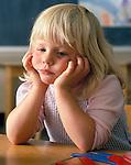 Preschool girl looking sad