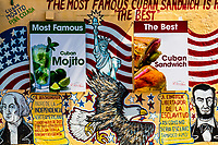 Calle Ocho street art of American presidents' symbols while advertising for mojito, in the Cuban Little Havana neighborhood of Miami, Florida USA