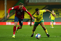 6th April 2021; Carrow Road, Norwich, Norfolk, England, English Football League Championship Football, Norwich versus Huddersfield Town; Onel Hernandez of Norwich City competes for the ball with Richard Keogh of Huddersfield Town