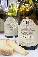 bottle with moulded relief on neck glass of arbois savagnin comte cheese domaine de la pinte arbois france