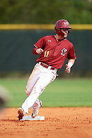 Boston College Eagles shortstop Jake Palomaki (11) takes second base on a passed ball during a game against the Minnesota Golden Gophers on February 23, 2018 at North Charlotte Regional Park in Port Charlotte, Florida.  Minnesota defeated Boston College 14-1.  (Mike Janes/Four Seam Images)