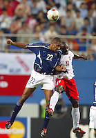 Tony Sanneh goes up for a header. The USA lost 3-1 against Poland in the FIFA World Cup 2002 in Korea on June 14, 2002.