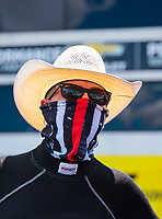 Jul 11, 2020; Clermont, Indiana, USA; NHRA top fuel driver Steve Torrence wears a face mask covering during qualifying for the E3 Spark Plugs Nationals at Lucas Oil Raceway. This is the first race back for NHRA since the start of the COVID-19 global pandemic. Mandatory Credit: Mark J. Rebilas-USA TODAY Sports