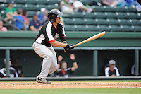 Catcher Jorge Alfaro (11) of the Hickory Crawdads bats in a game against the Greenville Drive on Sunday, June 9, 2013, at Fluor Field at the West End in Greenville, South Carolina. Alfaro is the No. 9 prospect of the Texas Rangers, according to Baseball America. Hickory won, 6-3. (Tom Priddy/Four Seam Images)