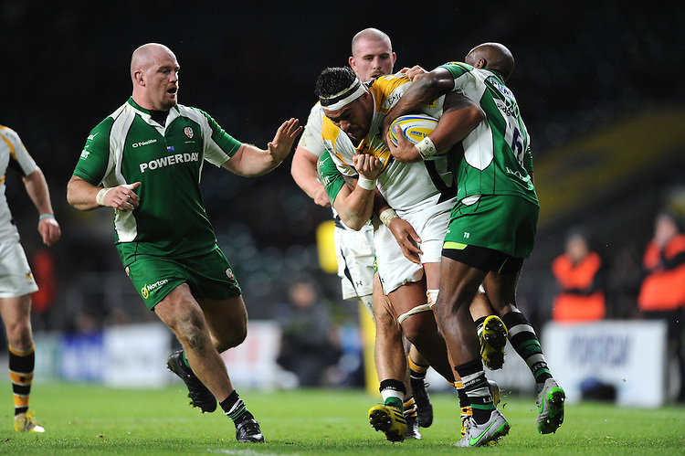 Nathan Hughes of Wasps is tackled by Topsy Ojo of London Irish as Ben Franks of London Irish supportsduring the Premiership Rugby match between London Irish and Wasps - 28/11/2015 - Twickenham Stadium, London<br /> Mandatory Credit: Rob Munro/Stewart Communications