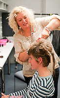 """One of the volunteer hairdressers at work.  Special Olympics Surrey put on a show,   """"Beyond the Stars"""", at the Rose Theatre, Kingston upon Thames to raise money for the  SOGB team.  The Special Olympics are for athletes with learning disabilities."""