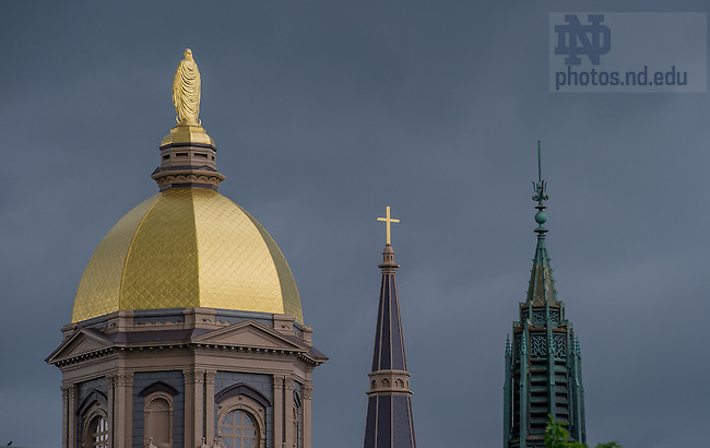 Jun. 2, 2014; Main Building, Basilica steeple, and the spire of St. Liam Hall on a rainy June afternoon.<br /> <br /> Photo by Matt Cashore/University of Notre Dame