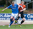 St Johnstone's Brian Easton and Dundee Utd's Gary Mackay-Steven challenge for the ball.