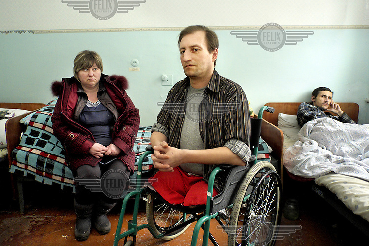 Yura (43) and his sister pose for a photo. On October 9, 2014 Yura was in front of his house on Luzina Street, Oktyabrskyi district, when a bomb exploded about three meters from him. His legs were amputated in the army hospital, but he got gangrene and later more had to be amputated. Eastern Ukraine has seen heavy fighting between pro-Russia separatists and the Ukrainian army in the Donetsk and Lugansk regions since the overthrow of President Viktor Yanukovych in February 2014.