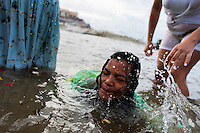 A Candomblé follower becomes possessed in the water during the ritual celebration of Yemanjá, the goddess of the sea, in Salvador, Bahia, Brazil, 2 February 2012. Yemanjá, originally from the ancient Yoruba mythology, is one of the most popular ?orixás?, the deities from the Afro-Brazilian religion of Candomblé. Every year on February 2nd, thousands of Yemanjá devotees participate in a colorful celebration in her honor. Faithful, usually dressed in the traditional white, gather on the beach at dawn to leave offerings for their goddess. Gifts for Yemanjá include flowers, perfumes or jewelry. Dancing in the circle and singing ancestral Yoruba prayers, sometimes the followers enter into a trance and become possessed by the spirits. Although Yemanjá is widely worshipped throughout Latin America, including south of Brazil, Uruguay, Cuba or Haiti, the most popular cult is maintained in Bahia, Brazil.