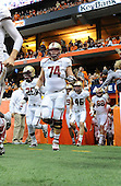 Boston College Eagles lineman Dave Bowen (74), linebacker Josh Keyes (25), safety Sean Burke (46) and tight end Michael Giacone (88) coming of the tunnel before a game against the Syracuse Orange at the Carrier Dome on November 30, 2013 in Syracuse, New York.  Syracuse defeated Boston College 34-31.  (Copyright Mike Janes Photography)