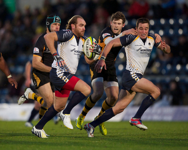 Andy Goode of Worcester Warriors makes a break during the LV= Cup second round match between London Wasps and Worcester Warriors at Adams Park on Sunday 18th November 2012 (Photo by Rob Munro)