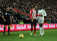 Pictured: Modou Barrow of Swansea (R) is arguing with Ryan Bertrand of Southampton Sunday 01 February 2015<br />