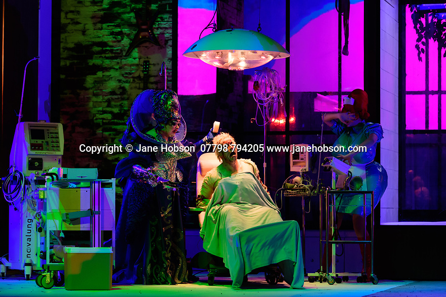 """EMBARGOED UNTIL 23:00 FRIDAY 18 OCTOBER 2019: English National Opera presents """"The Mask of Orpheus"""", by Sir Harrison Birthwhistle, libretto by Peter Zinovieff, at the London Coliseum, in its first London restaging in the 30 years since its premiere, coinciding with the celebration of Sir Harrison's 85th birthday. Directed by Daniel Kramer, with lighting design by Peter Mumford, set design by Lizzie Clachan and costume design by Daniel Lismore. Picture shows: Claire Barnett Jones (Eurydice the Myth), Daniel Norman (Orpheus the Myth)"""