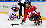 Sochi, RUSSIA - Mar 13 2014 - Adam Dixon controls the puck as Canada takes on USA in Sledge Hockey Semi-Final at the 2014 Paralympic Winter Games in Sochi, Russia.  (Photo: Matthew Murnaghan/Canadian Paralympic Committee)