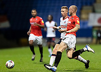 Bolton Wanderers' Eoin Doyle competing with Salford City's Tom Clarke (right) <br /> <br /> Photographer Andrew Kearns/CameraSport<br /> <br /> The EFL Sky Bet League Two - Bolton Wanderers v Salford City - Friday 13th November 2020 - University of Bolton Stadium - Bolton<br /> <br /> World Copyright © 2020 CameraSport. All rights reserved. 43 Linden Ave. Countesthorpe. Leicester. England. LE8 5PG - Tel: +44 (0) 116 277 4147 - admin@camerasport.com - www.camerasport.com