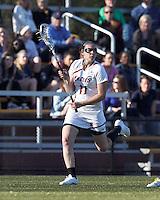 Boston College midfielder Kara Magley (11) brings the ball forward.