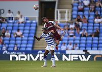 21st July 2021; Madejski Stadium, Reading, Berkshire, England; Pre Season Friendly Football, Reading versus West Ham United; Aaron Cresswell of West Ham competes in the air with Tennai Watson of Reading