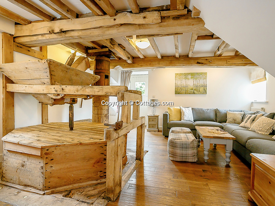 BNPS.co.uk (01202 558833)<br /> Pic: Cottages.com/BNPS<br /> <br /> A mother who became a property developer to support her daughters after a divorce has unveiled her latest stunning holiday let - a stunning converted 15th century water mill.<br /> <br /> Sandy Potter, 53, has transformed The Water Mill, in Derbys, into a 16 person detached holiday home nestled in the heart of the idyllic Peak District countryside.<br /> <br /> The Grade II listed property features in the Domesday Records and was used to mill corn and wheat until about 1960.<br /> <br /> She has restored its 300 year old water wheel, and the seven bedroom holiday home retains its ancient stonework and oak beams.<br /> <br /> More modern touches include a luxurious Champagne bar and a hot tub.