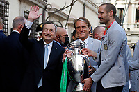 Matteo Berrettino. Giorgio Chiellini, Mario Draghi and Roberto Manciniwith the cup during the visit of the Italian National team at Palazzo Chigi, where the athletes met the Italian Premier after winning the UEFA Euro 2020 cup.<br /> Rome (Italy), July 12th 2021<br /> Photo Samantha Zucchi Insidefoto