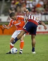 Houston Dynamo defender Wade Barrett and Chivas USA midfielder Juan Pablo Garcia battle for the ball.  Houston Dynamo and Chivas USA drew to a 0-0 tie at Robertson Stadium in Houston, TX on September 17, 2006.