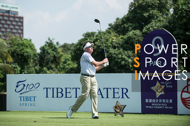 Rich Beem tees off the 9th hole during the World Celebrity Pro-Am 2016 Mission Hills China Golf Tournament on 22 October 2016, in Haikou, China. Photo by Marcio Machado / Power Sport Images