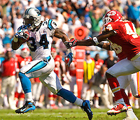 Carolina Panthers running back DeAngelo Williams (34) runs the ball past Kansas City Chiefs FS Jarrad Page (44) during a NFL football game at Bank of America Stadium in Charlotte, NC.