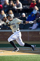 Christian Long (19) of the Wake Forest Demon Deacons follows through on his swing against the Gardner-Webb Runnin' Bulldogs at David F. Couch Ballpark on February 18, 2018 in  Winston-Salem, North Carolina.  The Demon Deacons defeated the Runnin' Bulldogs 8-4 in game one of a double-header.  (Brian Westerholt/Four Seam Images)