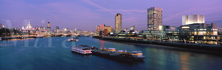 Dusk over the River Thames with St Paul's Cathedral, the City and South Bank, London. From Waterloo Bridge.