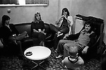 """Paul and Linda McCartney  Wings Tour 1975. Linda makes a face at JoJo Laines child who is traveling with them. Jimmy McCulloch on the left, Linda and Colin Allen, an English Blues drummer and member of Stone the Crows. Manchester England. I was on tour with Wings for a children's book """"Facts about a Pop Group Featuring Wings."""" Introduced by Paul McCartney, published by G.Whizzard. They had recently recorded albums, Wildlife, Red Rose Speedway, Band on the Run and Venus and Mars. I believe it was the English leg of Wings Over the World tour. But as I recall they were promoting,  Band on the Run and Venus and Mars in particular."""