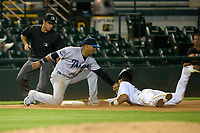 Tampa Tarpons third baseman Roberto Chirinos (14) tags Endy Rodriguez (5) out as umpire Joe McCarthy looks on to make the call during Game One of the Low-A Southeast Championship Series against the Bradenton Marauders on September 21, 2021 at LECOM Park in Bradenton, Florida.  (Mike Janes/Four Seam Images)