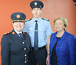 15/9/2014    The Minister for Justice & Equality Frances Fitzgerald, TD and Garda Commissioner Noirin O'Sullivan photographed with one of the  first students who arrived at the Garda College Templemore since 2009.  Student Garda Joseph Byrne a dad of 3,  Saoirse(4), Oisin(3) and Lucy(18 months) is from Roundwood, Wicklow.  Picture Liam Burke Press 22