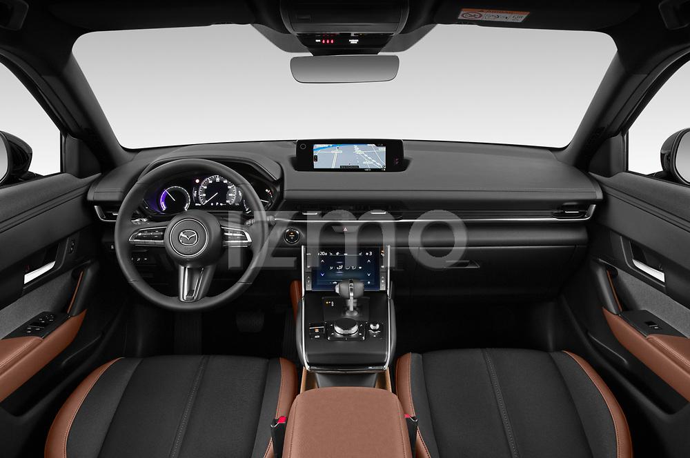 Stock photo of straight dashboard view of 2021 Mazda MX-30 Skycruise 5 Door SUV Dashboard