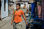 A woman walks in the street in Suto Orizari, Macedonia. The mostly Roma community, located just outside Skopje, is Europe's largest Roma settlement. .