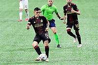 ATLANTA, GA - APRIL 24: Atlanta United midfielder #8 Ezequiel Barco passes the ball during a game between Chicago Fire FC and Atlanta United FC at Mercedes-Benz Stadium on April 24, 2021 in Atlanta, Georgia.
